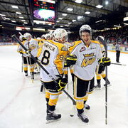 The Brandon Wheat Kings celebrate after their 5-1 win over the Regina Pats Friday night.