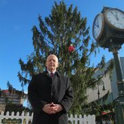 In this Dec. 12, 2014 photo City Councilman Jeff Waltman poses in front of the city's official Christmas tree in Reading, Pa. Waltman fought to save the 50-foot Norway spruce that many residents compared to the spindly tree in