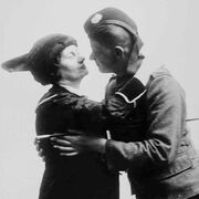 Soldier in farewell embrace, 1914.