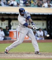 Houston Astros' Chris Carter drives in two runs with a single during the third inning of a baseball game against the Oakland Athletics on Tuesday, July 22, 2014, in Oakland, Calif. (AP Photo)