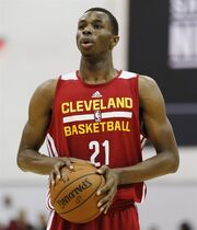 Andrew Wiggins of the Cleveland Cavaliers prepares to take a free throw against the Milwaukee Bucks in an NBA summer league basketball Friday, July 11, 2014, in Las Vegas. Wiggins will sign his rookie contract with the Cavaliers. It's still not clear if he'll play for them. THE CANADIAN PRESS/AP/John Locher