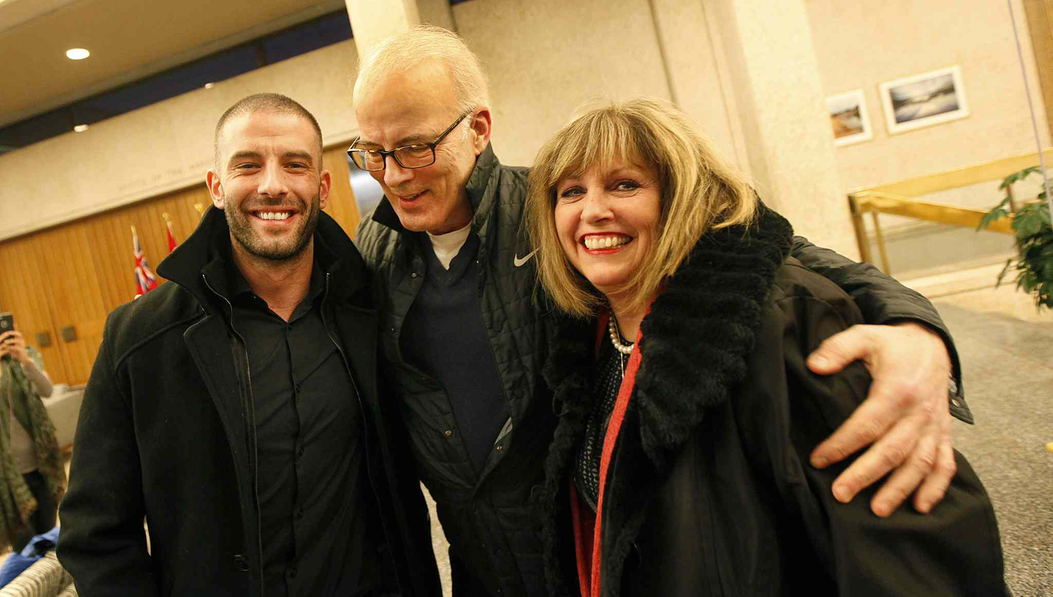 PHIL HOSSACK / Winnipeg Free Press - Left to right - Darcy Oake and his parents Scott and Anne celebrate after a city council vote approving the recovery centre at the Vimy Arena site Thursday.   -  January 25, 2018