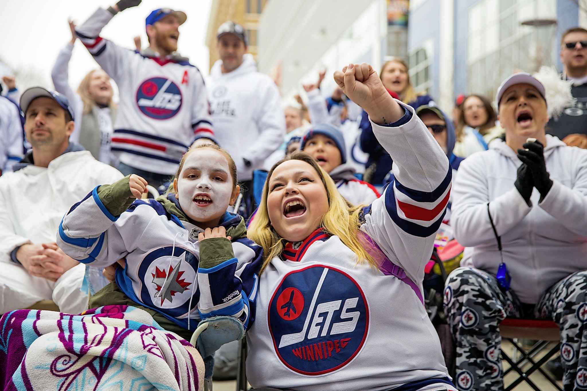 Danielle (left) and Lacey Lavallee cheer the Jets on during last year's whiteout party on Donald Street. (Mikaela MacKenzie / Winnipeg Free Press files)