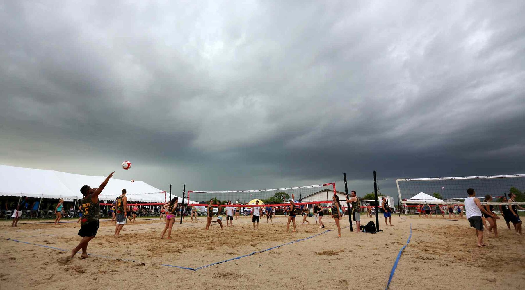 Storm clouds above Super-Spike volleyball tournament at Maple Grove Rugby Park, Friday, July 18, 2014.  (TREVOR HAGAN/WINNIPEG FREE PRESS)