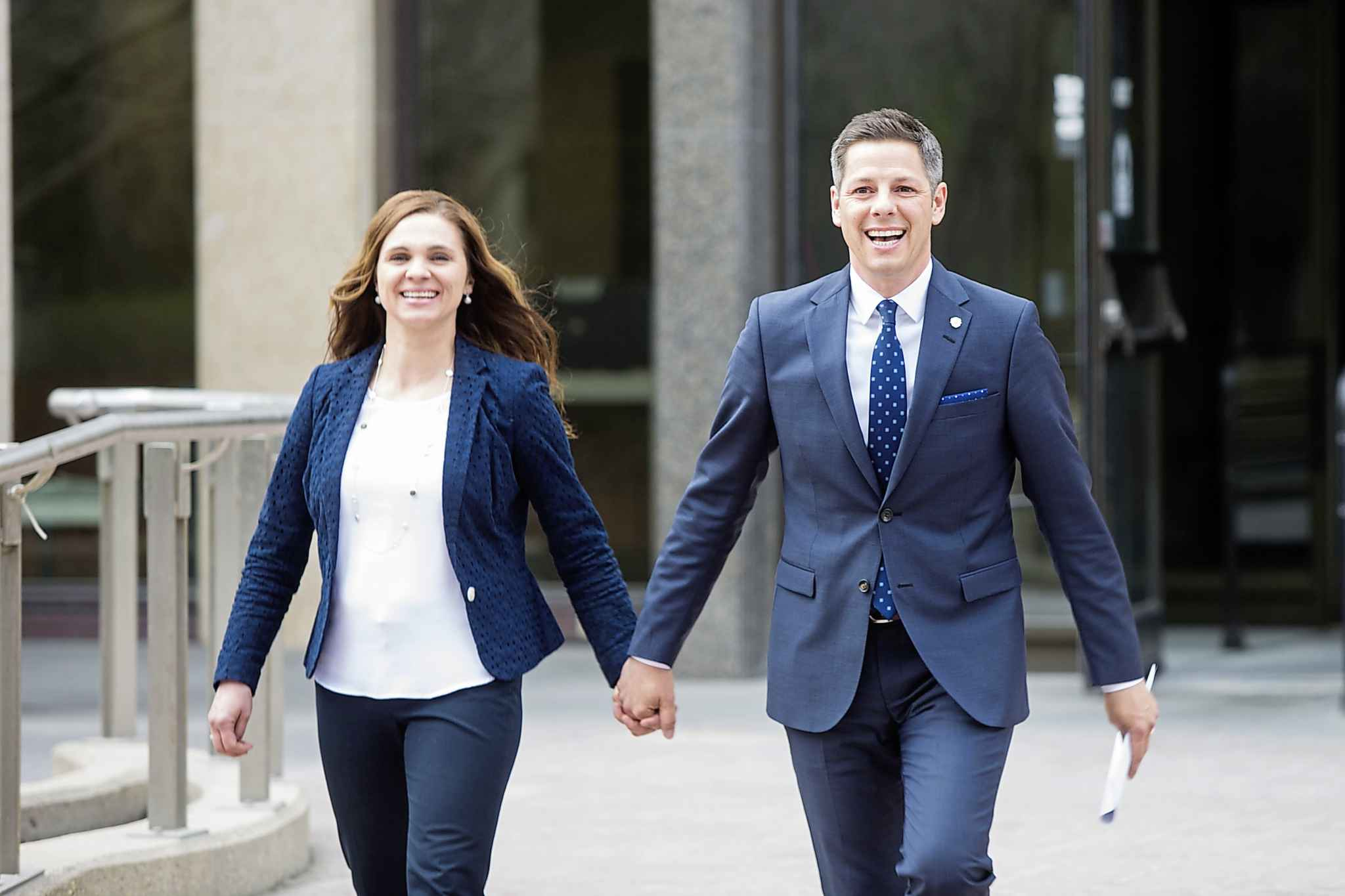MIKAELA MACKENZIE / WINNIPEG FREE PRESSMayor Brian Bowman and his wife, Tracy Bowman, walk to the clerk's office to register to seek re-election at City Hall in Winnipeg on Friday, May 11, 2018. Mikaela MacKenzie / Winnipeg Free Press 2018.