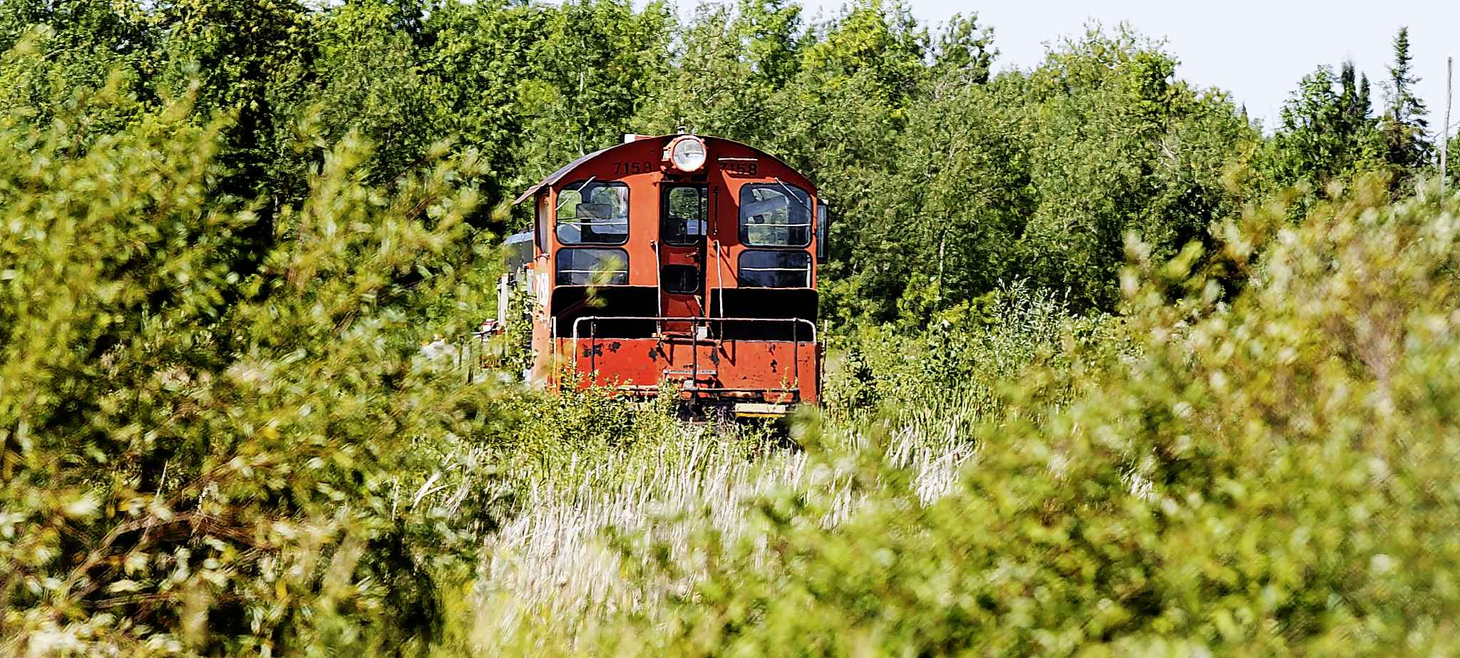 A rusting diesel locomotive sits on the site of the former paper mill. An attempt is being made to turn the property into a business park. (Phil Hossack / Winnipeg Free Press)