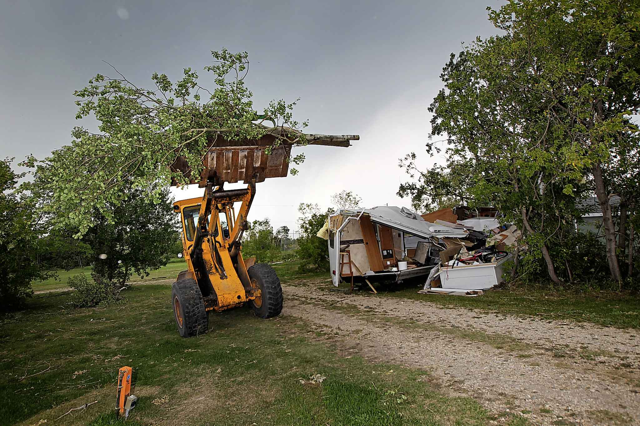 Jimmy Bruce uses a loader to clear debris from the Margaret Bruce Beach and campground.