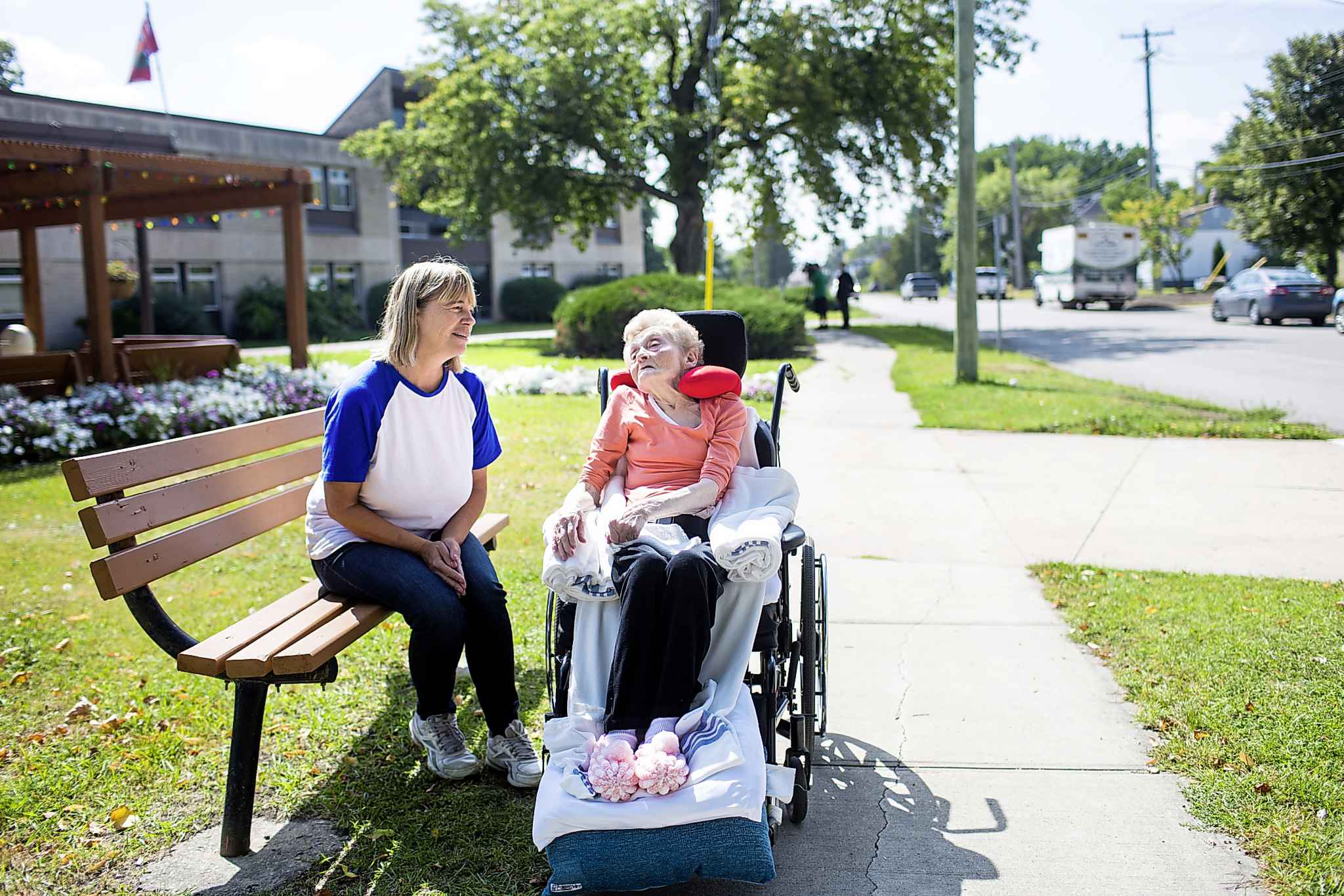 Winnie Best, resident at the Lions Prairie Manor Personal Care Home (right), and friend Adrienne Lasson enjoy the sun in Portage la Prairie.