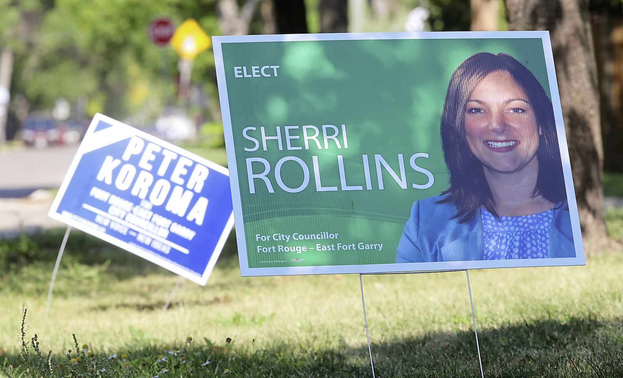 Election signs for Peter Koroma and Sherri Rollins for the city council seat for Fort Rouge.