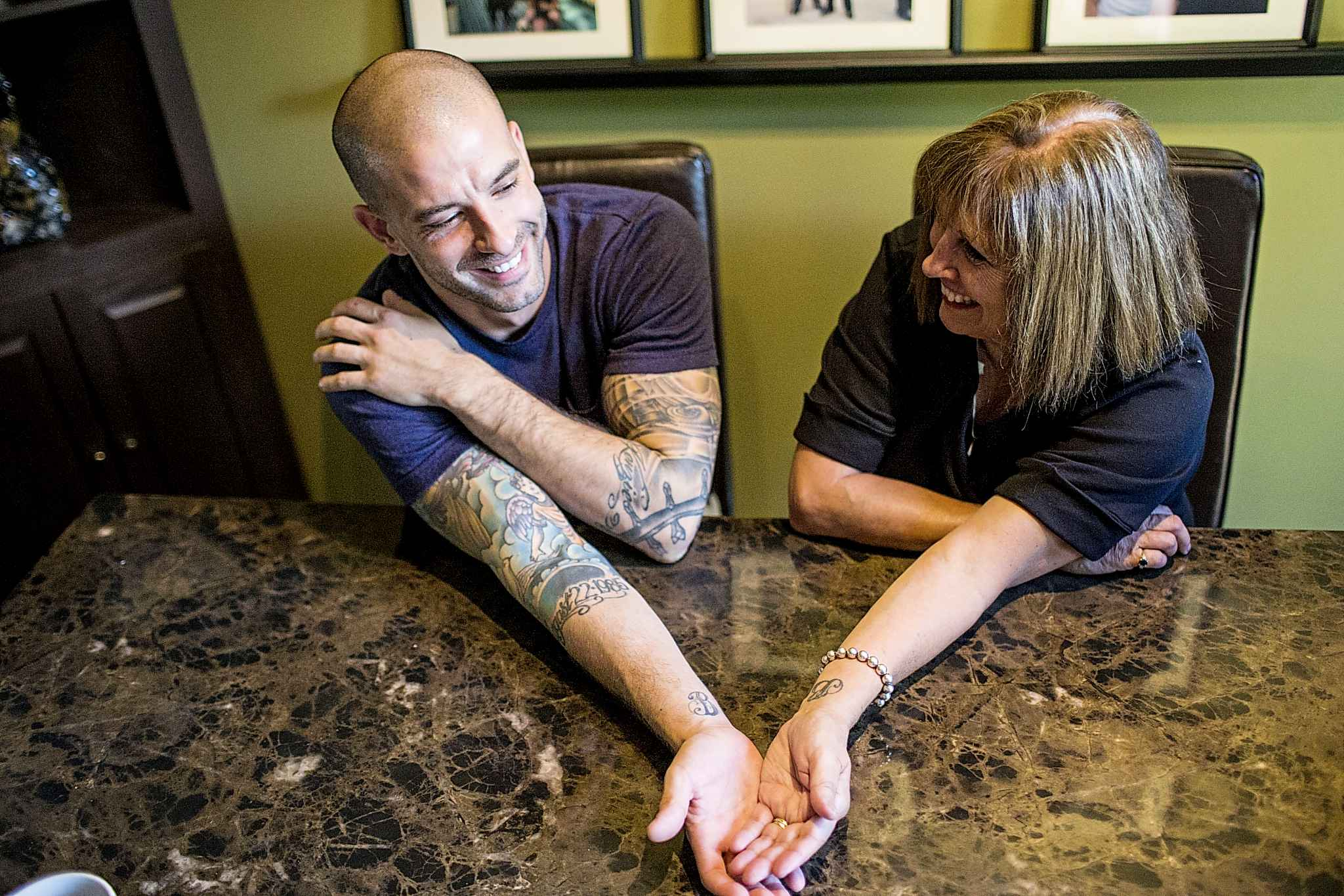 Darcy (left) and Anne Oake show their matching tattoos in memory of Bruce.