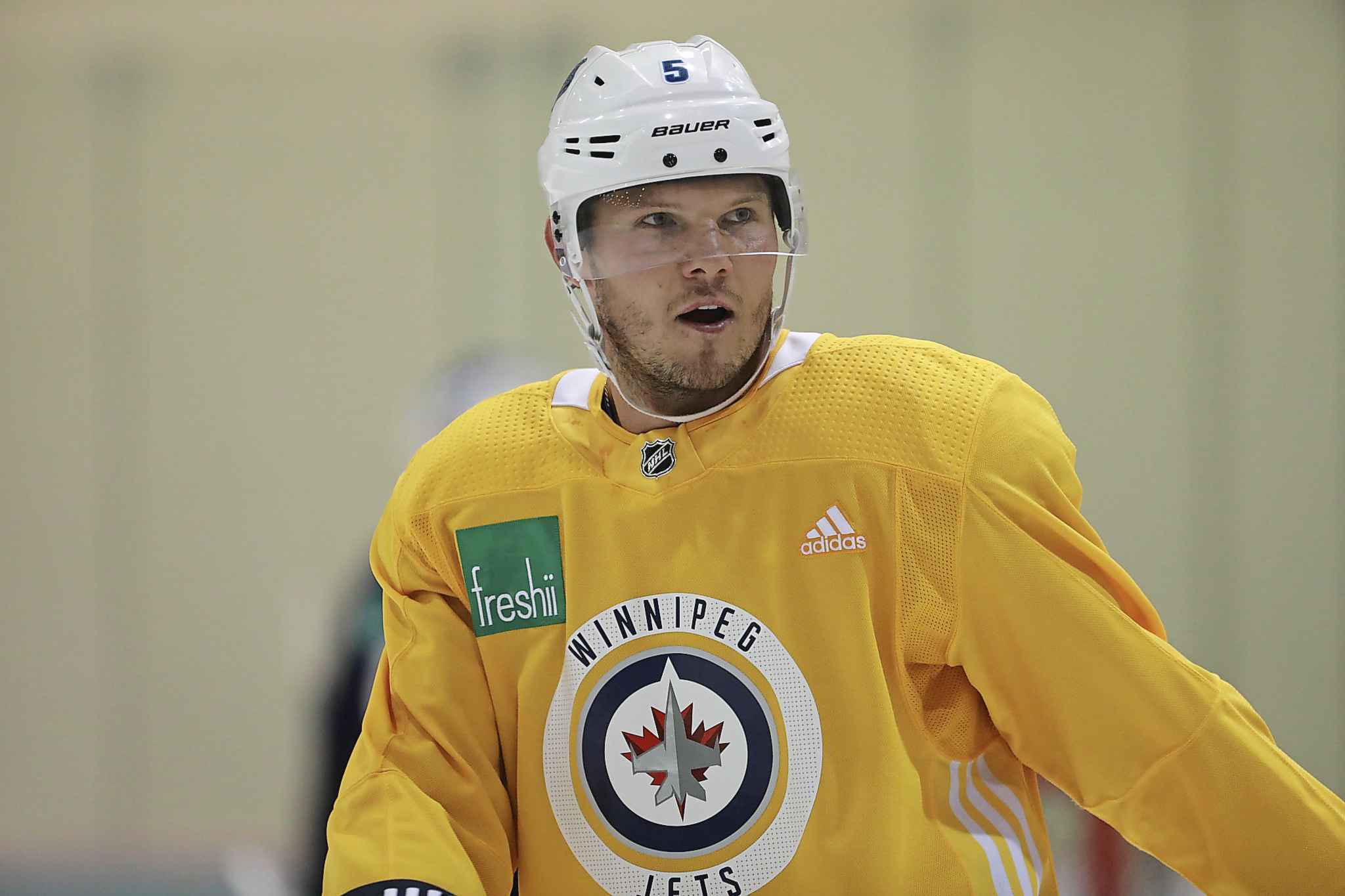 Dmitry Kulikov wore a yellow, non-contact jersey earlier this month when practicing with teammates.