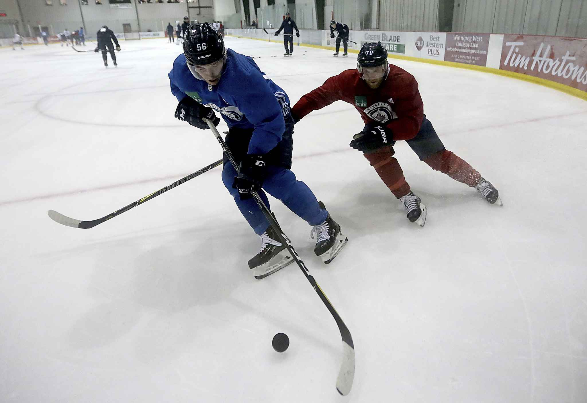 TREVOR HAGAN / WINNIPEG FREE PRESS</p><p>Winnipeg Jets' Marko Dano (56) and Joe Morrow (70) run through a drill Saturday morning at Bell MTS Iceplex.