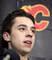 Calgary Flames' rookie Johnny Gaudreau speaks to the media as team members show up for season-end activities in Calgary on Monday, April 14, 2014. Known as