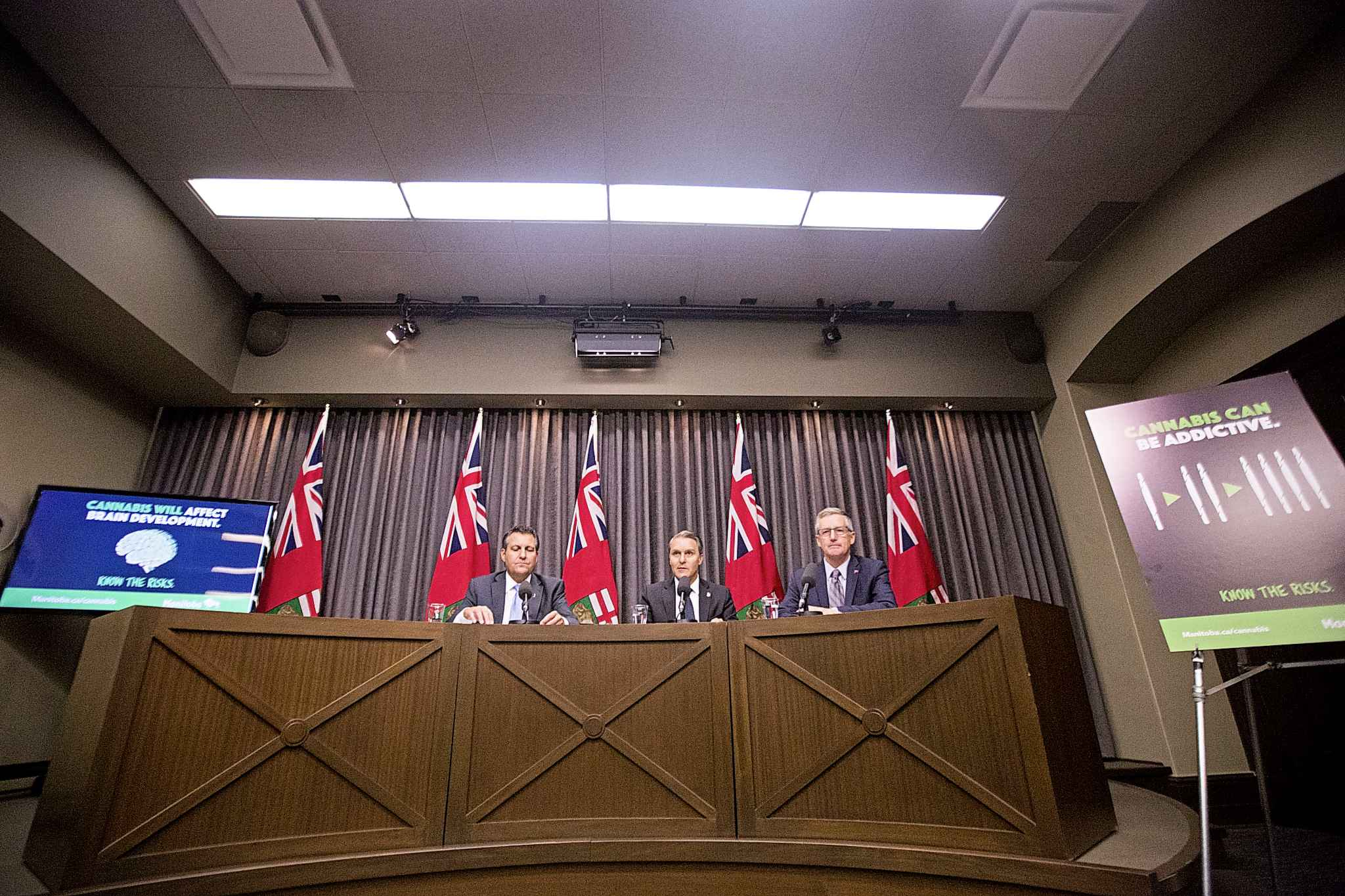 Justice Minister Cliff Cullen (left), Health, Seniors and Active Living Minister Cameron Friesen, and Growth, Enterprise and Trade Minister Blaine Pedersen talk cannabis with the media at the Manitoba Legislative Building on Wednesday.
