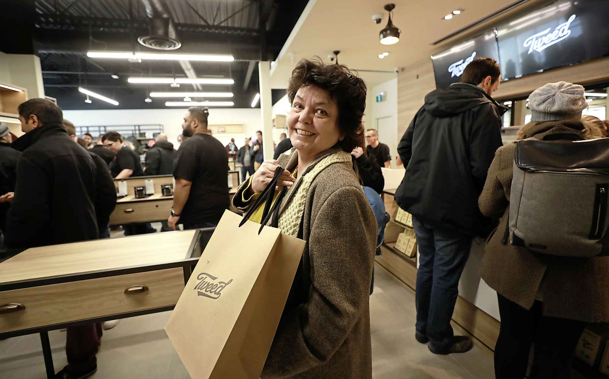 Susan Gibson finishes making her purchase of cannabis at Tweed store Wednesday.