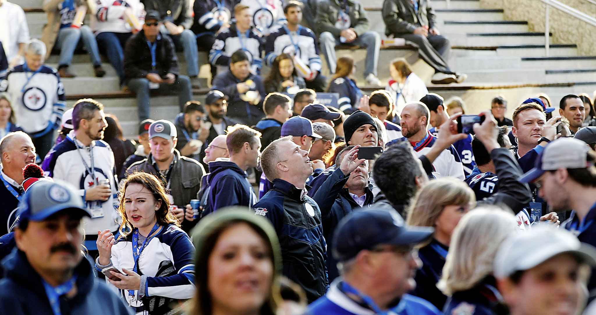 Winnipeg Jets ticket holders check out True North Square during a free pre-game concert headlined by Randy Bachman. (Phil Hossack / Winnipeg Free Press)