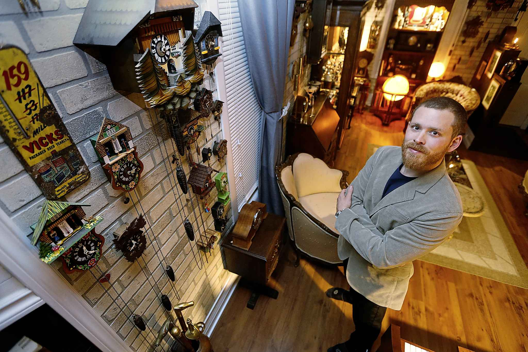 Covering almost every square inch of wall space in Beilby's living room are dozens and dozens of hand-carved cuckoo clocks.