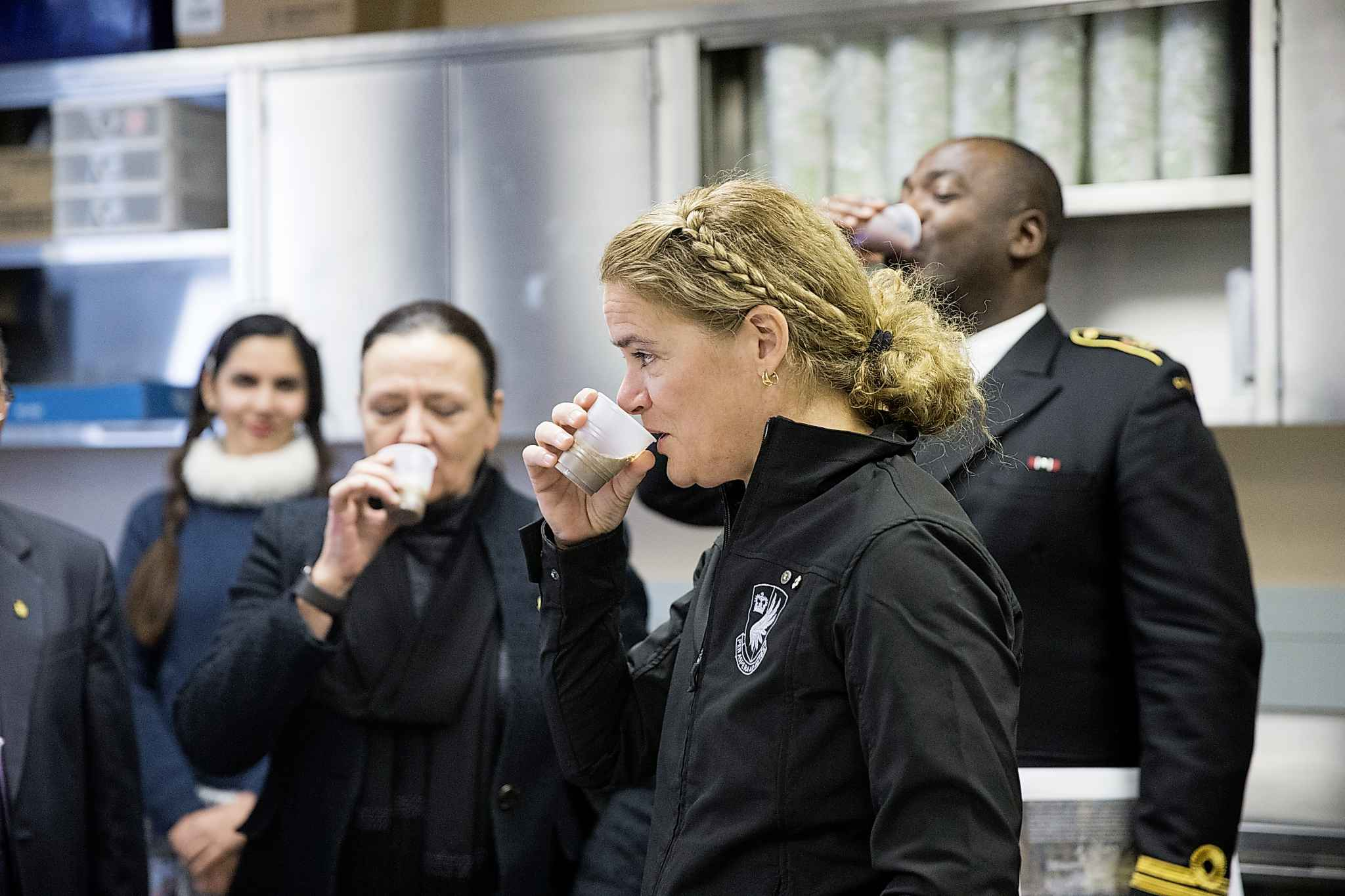 Payette tries a smoothie while touring labs at the Richardson Centre.