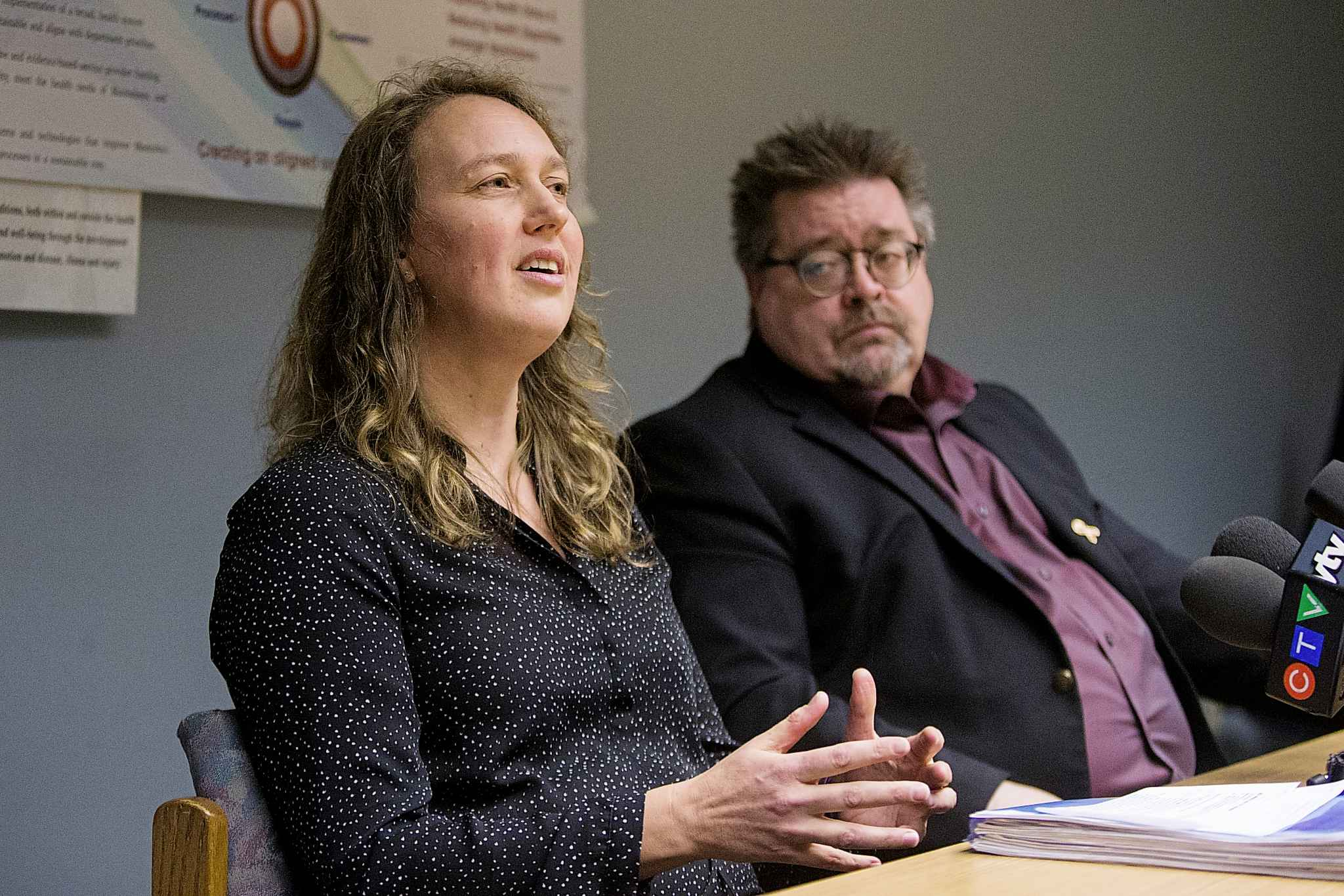 Lisa Richards, medical officer of health in Winnipeg (left), and Don Labossiere, director of environmental compliance and enforcement at Manitoba Sustainable Development, talk about soil contamination in Winnipeg.