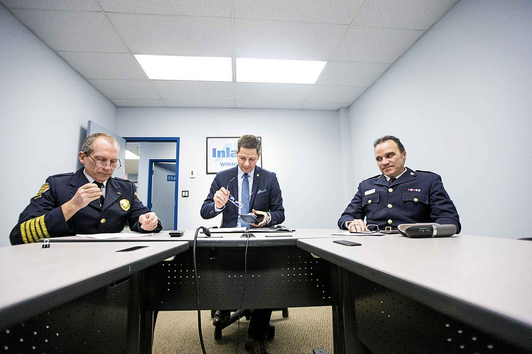 Winnipeg Fire Paramedic Service Chief John Lane (left), Mayor Brian Bowman, and Winnipeg Police Chief Danny Smyth appeared before the parliamentary standing committee on health on Tuesday via video conference.