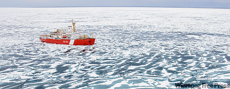 The Canadian Coast Guard ship Louis S. St. Laurent breaks ice near the mouth of Bellot Strait, NU in the Northwest Passage in the Artic Circle.