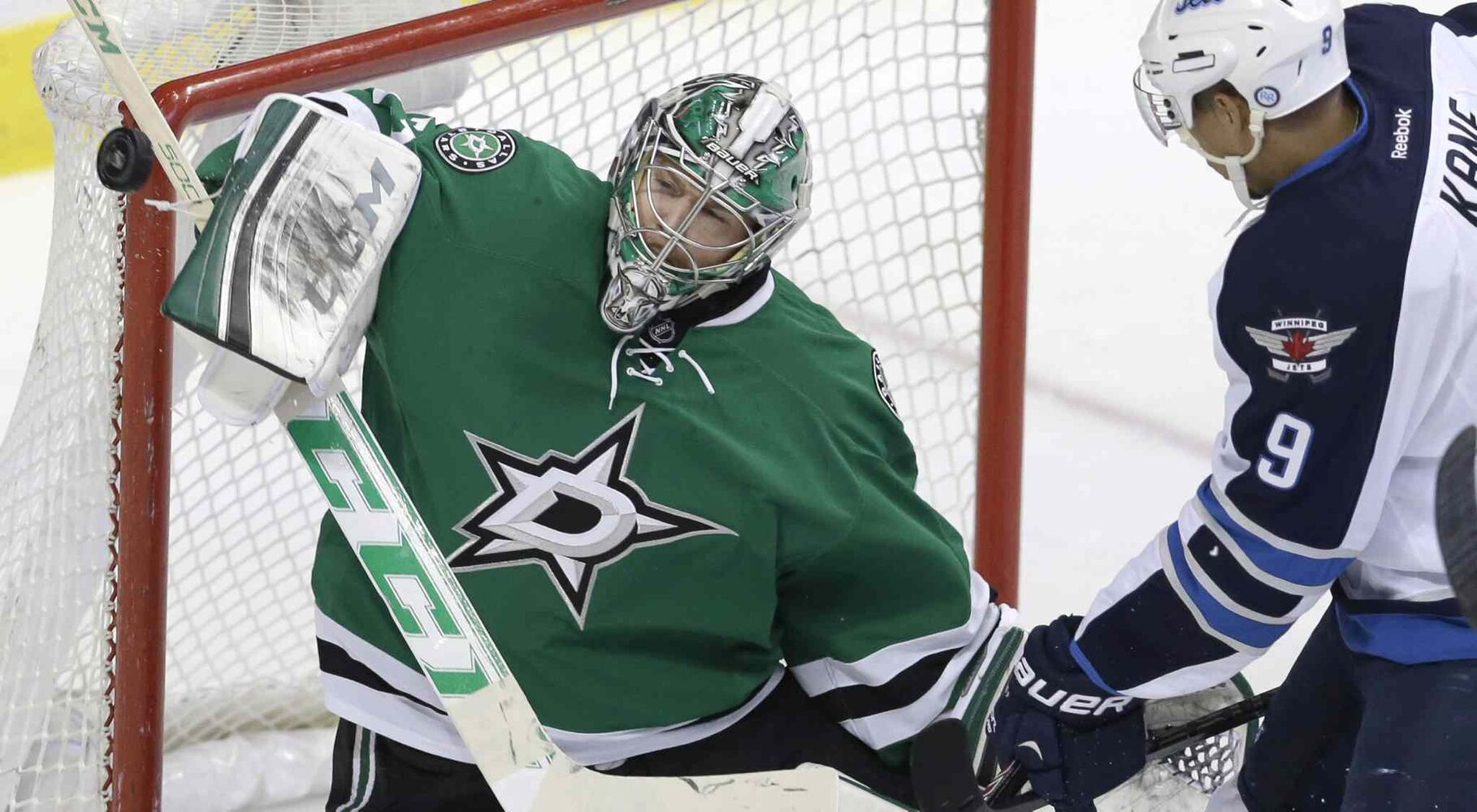 Dallas Stars goalie Kari Lehtonen blocks a shot from Winnipeg Jets left-winger Evander Kane (9) during the second period of an NHL game at American Airlines Arena in Dallas Monday. The Jets lost 2-1. (L.M. OTERO / THE ASSOCIATED PRESS)