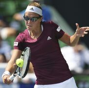 Kristen Flipkens of Belgium returns a shot against Dominika Cibulkova of Slovakia during their first round match of the Pan Pacific Open Tennis tournament in Tokyo Tuesday, Sept. 16, 2014. (AP Photo/Koji Sasahara)