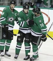 Dallas Stars center Jason Spezza (90) is congratulated by teammates Erik Cole (72) and Jamie Benn (14) after scoring a goal during the second period of an NHL hockey game against the Colorado Avalanche, Friday, Feb. 27, 2015, in Dallas. (AP Photo/LM Otero)