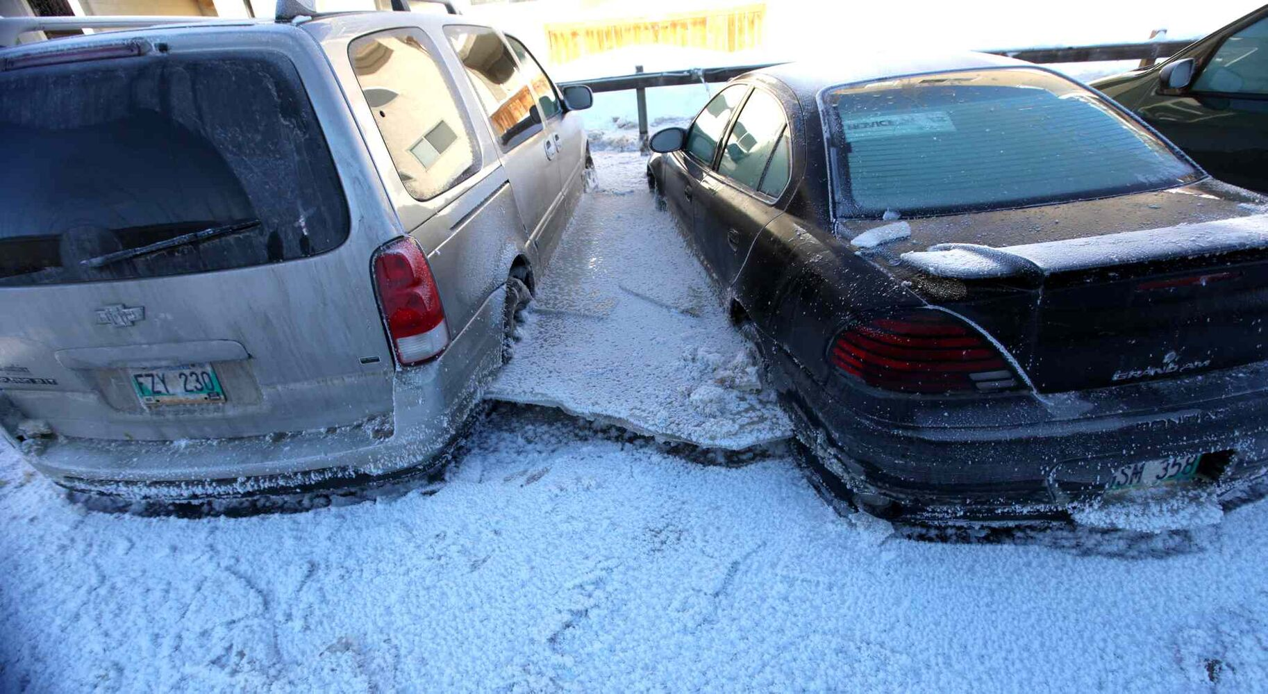 Vehicle stuck in ice after major water main break on New Year's Eve day on Jefferson.