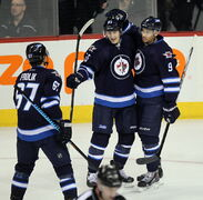 Mark Scheifele and Evander Kane celebrate Kane's goal during the first period at the MTS Centre Wednesday.