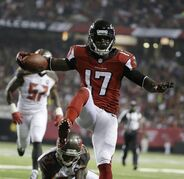 Atlanta Falcons wide receiver Devin Hester (17) runs into the end zone for a touchdown as Tampa Bay Buccaneers cornerback Johnthan Banks (27) defends during the first half of an NFL football game, Thursday, Sept. 18, 2014, in Atlanta. (AP Photo/David Goldman)