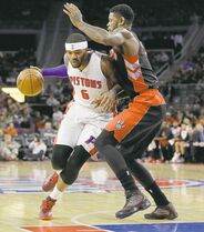 Pistons forward Josh Smith tries to drive past Raps defender Amir Johnson.