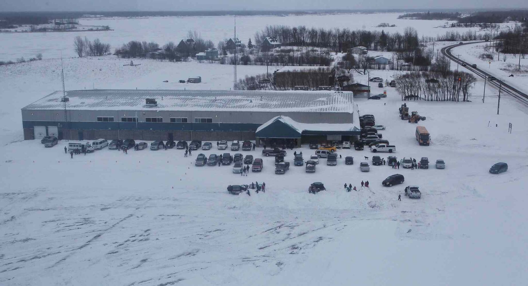 The crowds gather at the Sagkeeng Arena Multi-Plex as Santa's helicopter flies in for a landing at Sagkeeng First Nation during the Santa Express tour.