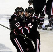 St. Cloud State forward Jonny Brodzinski , right, celebrates with teammate Patrick Russell following their overtime win over Michigan Tech during an NCAA college hockey tournament game Friday, March 27, 2015, in Fargo, N.D. (AP Photo/Bruce Crummy)