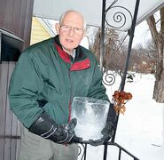 Buxton Road resident Henry Dueck shows off one of his ice lanterns.