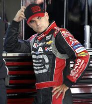 Driver Jeff Gordon takes a break as his crew works on his car during practice for Sunday's NASCAR Sprint Cup Series auto race at New Hampshire Motor Speedway, Friday, Sept. 19, 2014, in Loudon, N.H. (AP Photo/Jim Cole)
