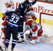 Winnipeg Jets' Andrew Ladd (16) celebrates after scoring on Carolina Hurricanes' goaltender Anton Khudobin (31) during first-period NHL hockey action in Winnipeg.