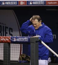 Kansas City Royals manager Ned Yost scratches his head during the sixth inning of Game 1 of baseball's World Series against the San Francisco Giants Tuesday, Oct. 21, 2014, in Kansas City, Mo. (AP Photo/Matt Slocum )