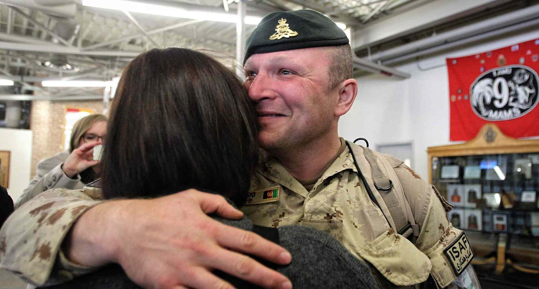 Sgt. David Chelkowski with the 1st RCHA is hugs his wife Jennifer after arriving in Winnipeg at 17 Wing from Afghanistan on Monday.