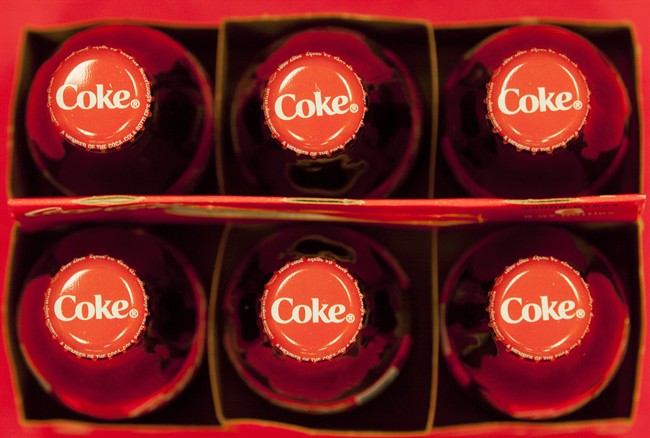 Bottle tops of Coca-Cola 8 oz. bottles are pictured in Doral, Fla. on July 15, 2013. THE CANADIAN PRESS/AP, Wilfredo Lee