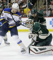 Minnesota Wild goalie Devan Dubnyk (40) catches the puck in front of St. Louis Blues center Paul Stastny (26) and Wild defenseman Matt Dumba, rear, during the second period of Game 6 of an NHL hockey first-round playoff series in St. Paul, Minn., Sunday, April 26, 2015. The Wild won 4-1 to win the series. (AP Photo/Ann Heisenfelt)