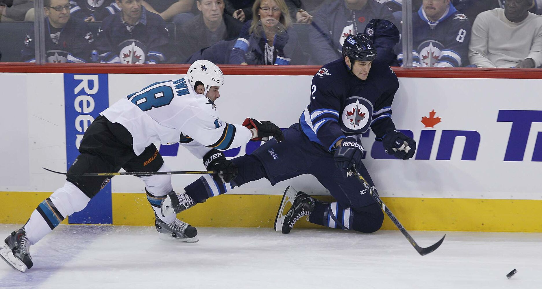 San Jose Sharks' Mike Brown (18) checks Winnipeg Jets' Adam Pardy (2) during the first period. (JOHN WOODS / WINNIPEG FREE PRESS)