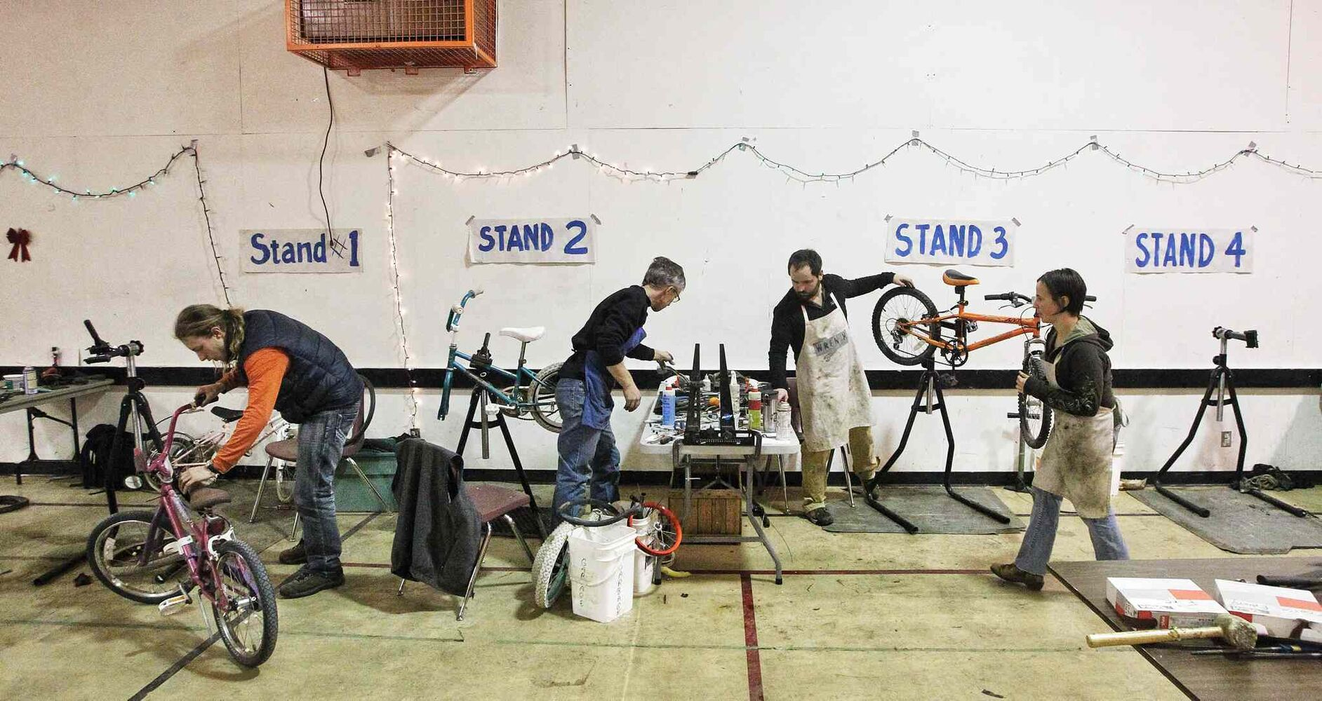 Volunteers get together at the Orioles Community Centre for a 24-hour bike repair marathon. Over 250 bicycles were repaired for children whose families can't afford to buy one for Christmas. (MIKE DEAL / WINNIPEG FREE PRESS)