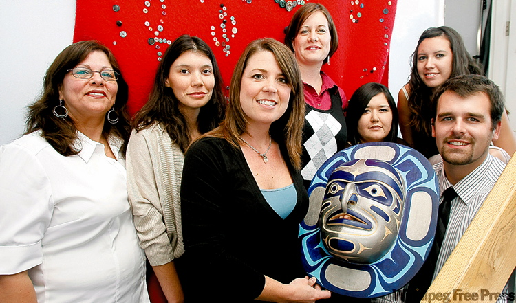 Kate Rexe (holding mask), with members of Sisters in Spirit, says the group�s plans have been put on hold.