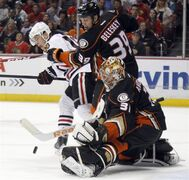 Anaheim Ducks goalie Frederik Andersen (31), of Denmark makes a stop with left wing Matt Beleskey (39) blocking out Chicago Blackhawks center Jonathan Toews, left, during the first period of an NHL hockey game in Anaheim, Calif., Friday, Jan. 30, 2015. (AP Photo/Alex Gallardo)