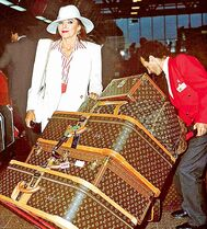 Back in the day, Joan Collins surely had no trouble finding her luggage.