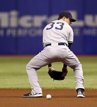 New York Yankees first baseman Kelly Johnson cannot handle a hit, resulting in a single for Tampa Bay Rays' Matt Joyce during the first inning of a baseball game Saturday, April 19, 2014, in St. Petersburg, Fla. (AP Photo/Mike Carlson)