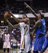 New Orleans Pelicans forward Anthony Davis (23) prepares to shoot in the first half of an NBA basketball game against the Dallas Mavericks in Bossier City, La., Thursday, Oct. 23, 2014. (AP Photo/Mike Silva)