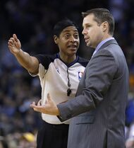 FILE - In this Nov. 20, 2013 file photo, Memphis Grizzlies coach David Joerger, right, speaks with referee Violet Palmer during the first half of an NBA basketball game against the Golden State Warriors in Oakland, Calif. Palmer, the first woman to referee an NBA game, says she will marry her longtime female partner this week. (AP Photo/Ben Margot, File)