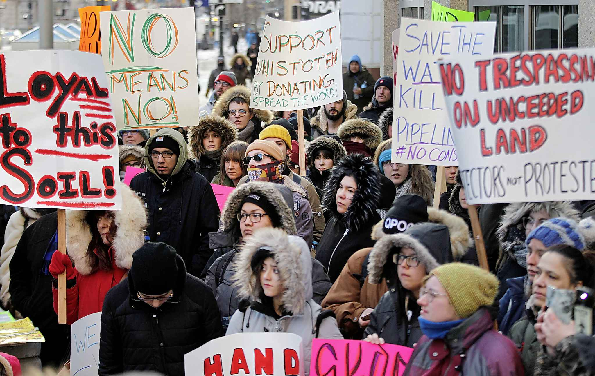 PHIL HOSSACK / WINNIPEG FREE PRESS Some of the hundreds gathered at Portage and Main Thursday.